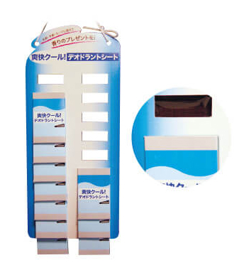 テープ貼りタイプの吊り下げ什器